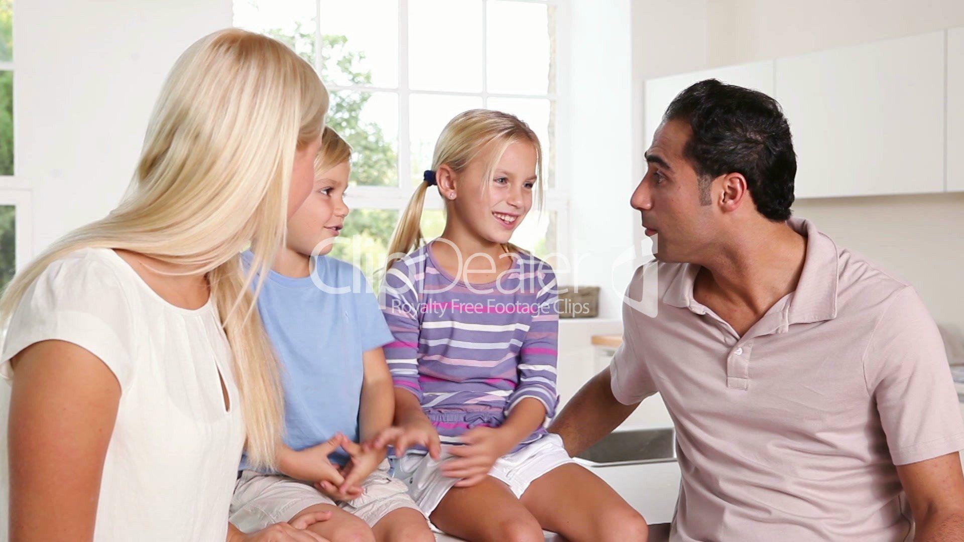 4–2258901-happyfamilytalkingtogether-happy-family