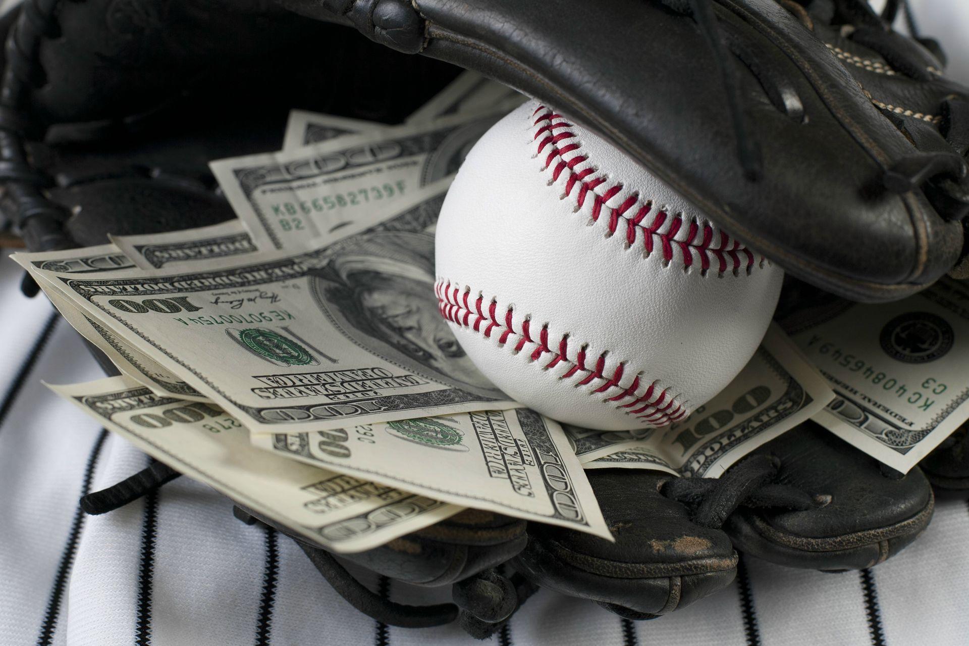 bigstock-business-of-baseball-and-money-34450892-money