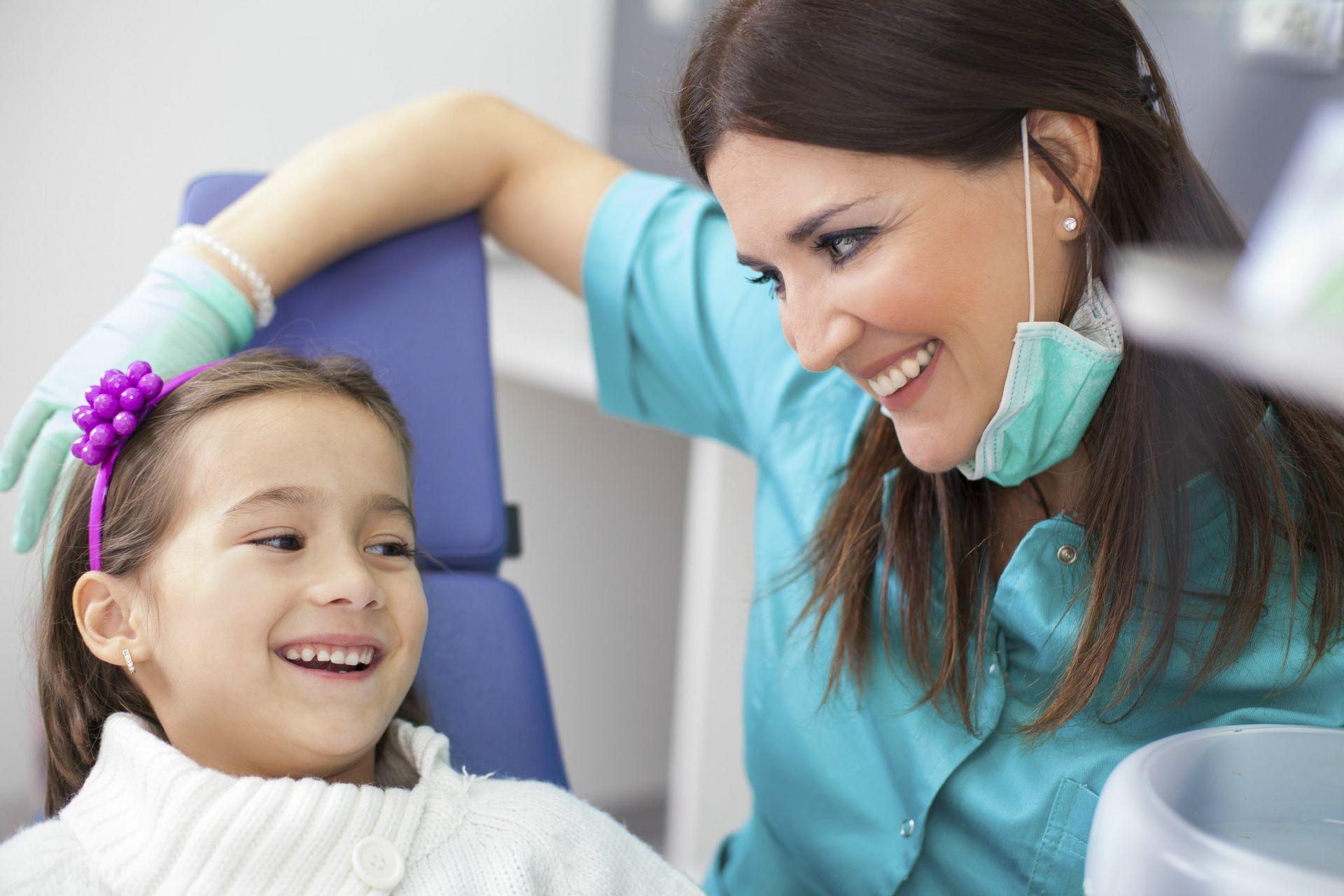 little-girl-and-green-scrubs.-dental-health