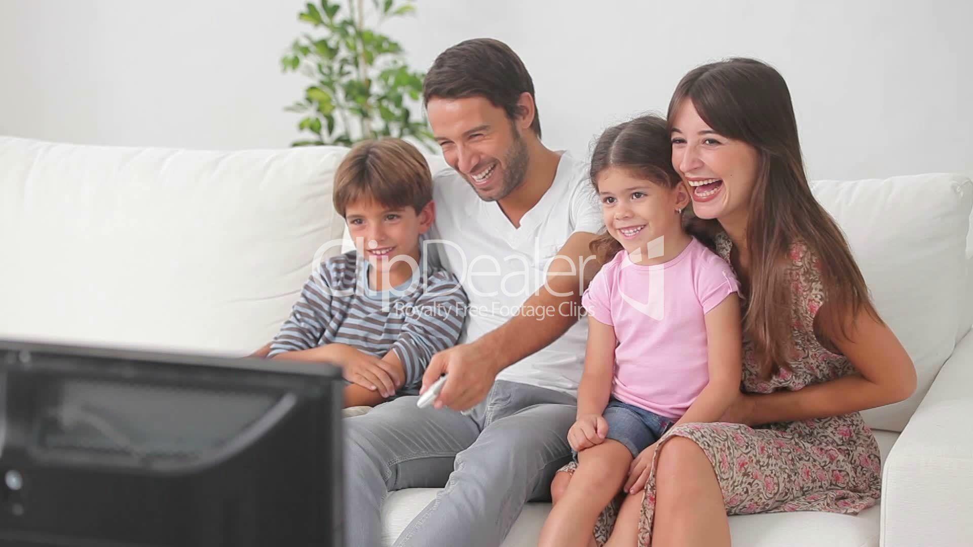 6–2258602-happyfamilywatchingtelevision-happy-family