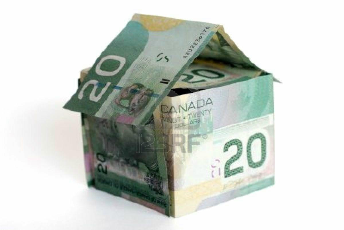818524-canadian-money-house-on-white-background-money