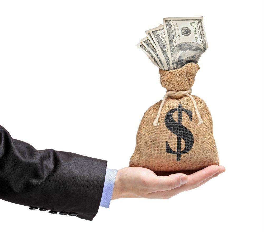 hand-holding-a-money-bag-money