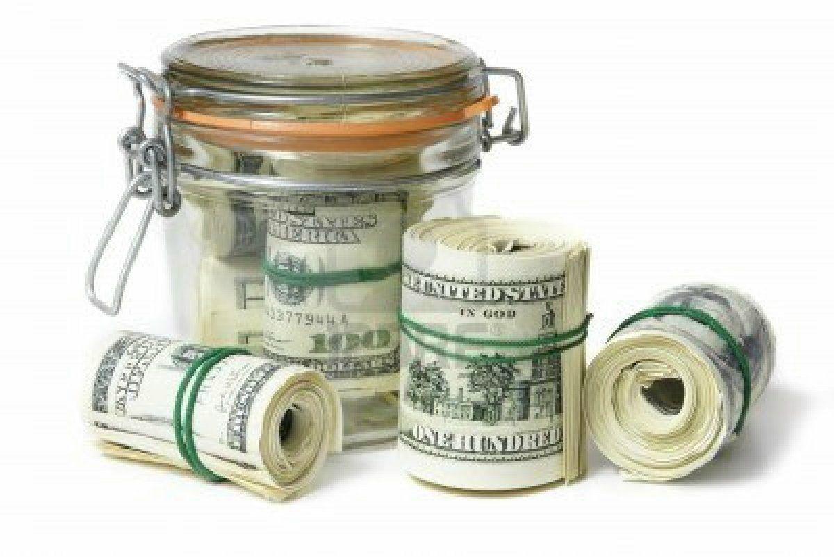 money-jar-filled-with-rolls-of-money-money